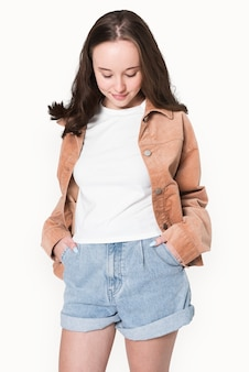 Girl in white t-shirt and brown jacket winter fashion shoot