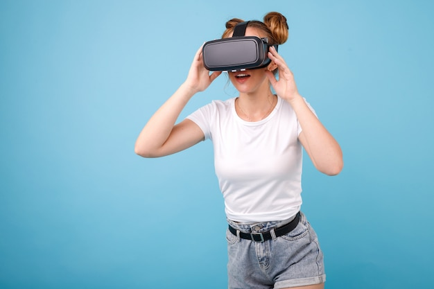 Girl in a white t-shirt and virtual reality glasses in the space