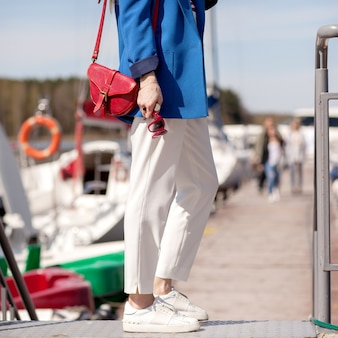 Girl in white trousers and a blue jacket