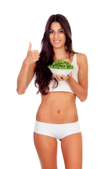 Girl in white underwear eating salda and saying ok