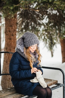 Girl in winter park covered of snow