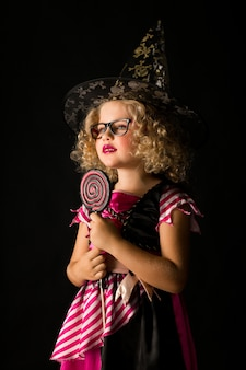 Girl in witch halloween costume