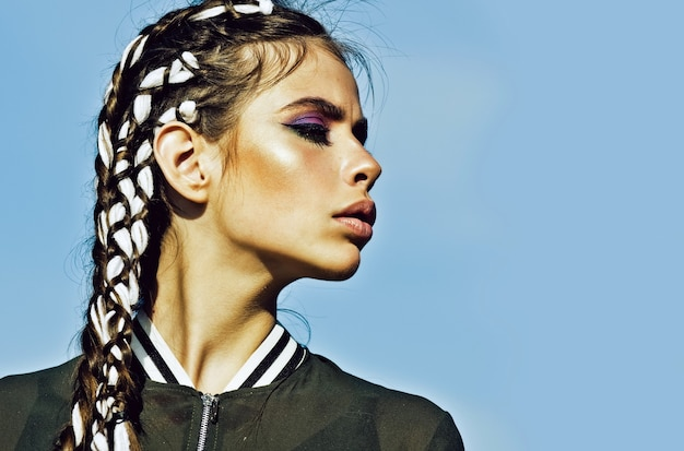 Girl with adorable face makeup and stylish braids