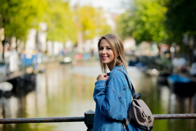 Girl with backpack in amsterdam