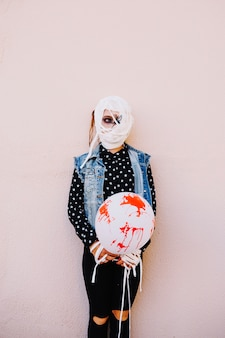 Girl with bandaged head and hands