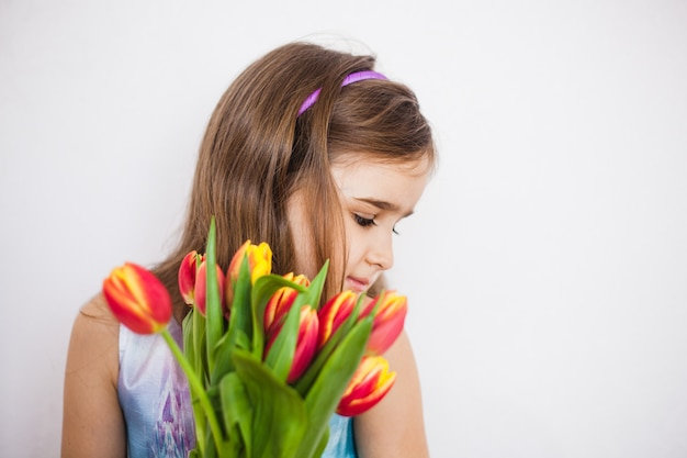 Girl with a big bouquet of tulips. girl with spring flowers.