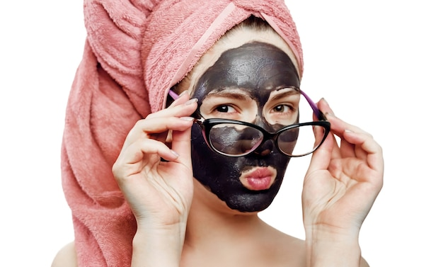 Girl with black face mask on the white background, close-up portrait, isolated, girl with a pink towel on her head, black mask on girl's face, business woman wearing glasses
