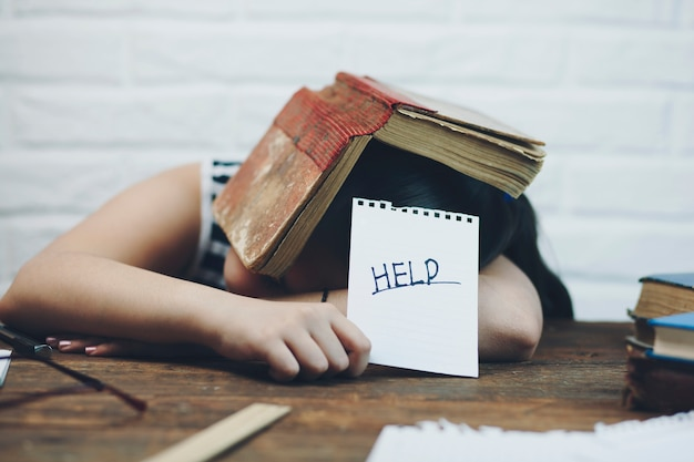 Girl with book asking help