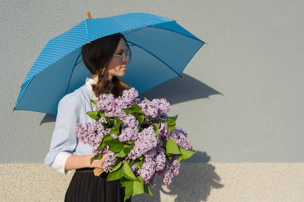 Girl with bouquet of lilacs, with an umbrella
