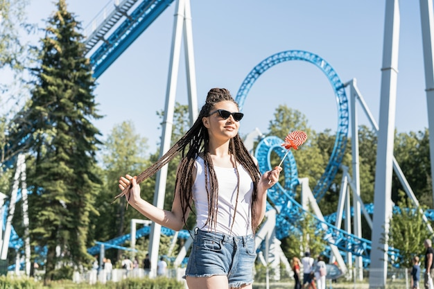 Girl with box braid hairstyle in an amusement park