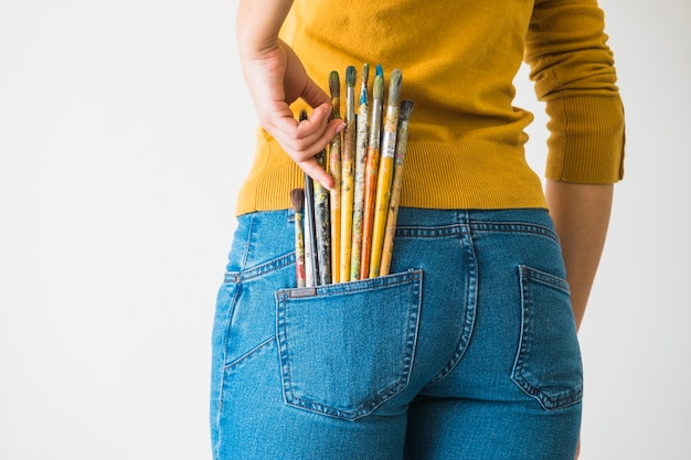Girl with brushes in the pocket