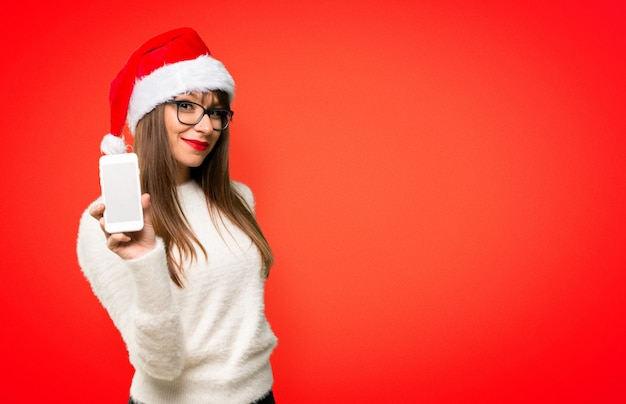 Girl with celebrating the christmas holidays looking at the camera and smiling