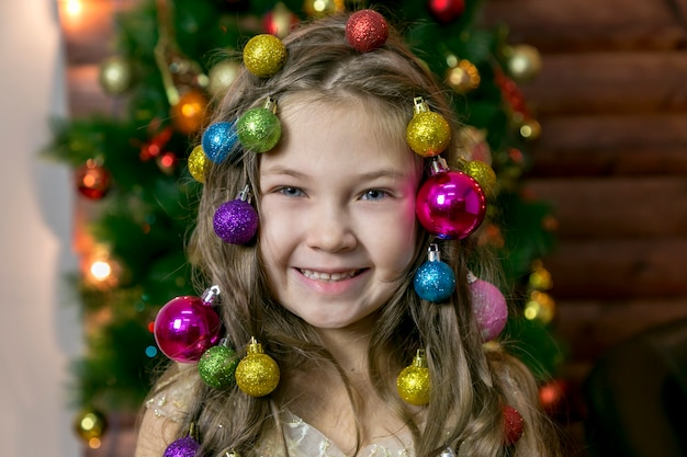 Girl with christmas decorations in her hair.