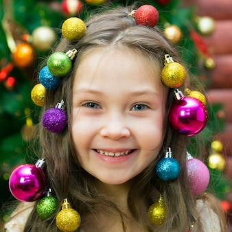 Girl with christmas decorations on her head.