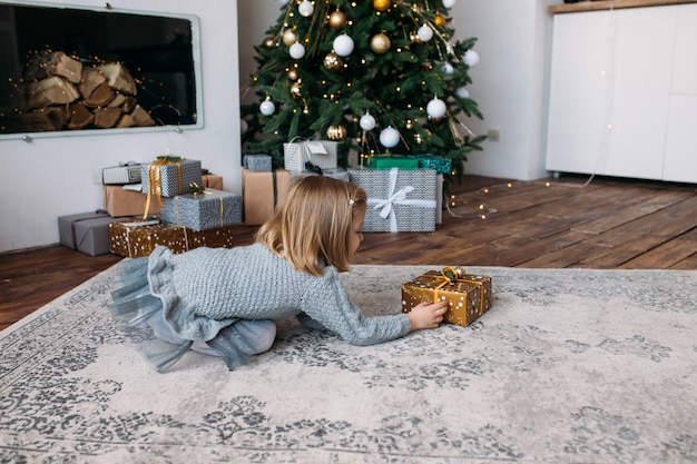 Girl with christmas gift box and decorations