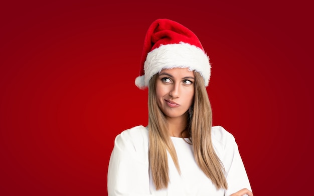 Girl with christmas hat thinking an idea