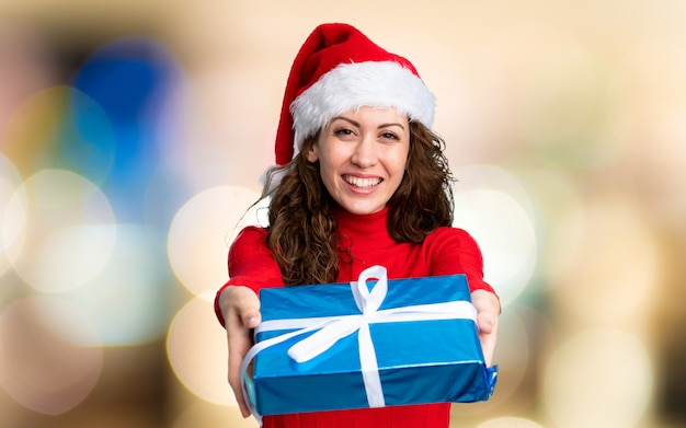Girl with christmas hat on unfocused wall