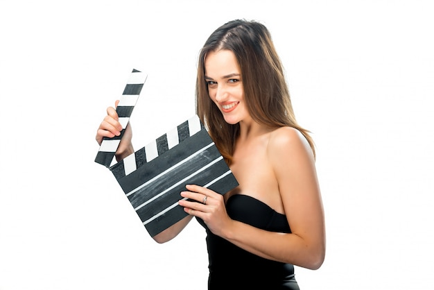 Girl with clapper board. people's emotions. close up. beauty with awesome smile. brunette opens clapperboard.