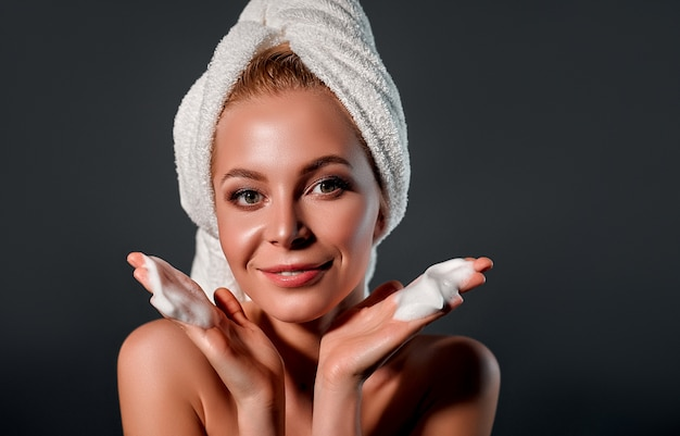Girl with cleansing foam.