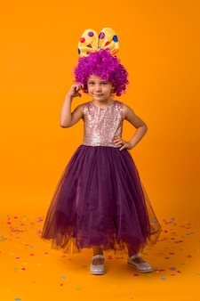 Girl with clown wig and tutu
