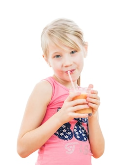 Girl with a cocktail of grapefruit isolated on white.