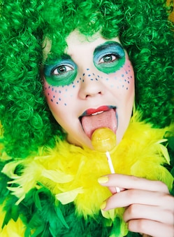 Girl with creative visage with lollipop