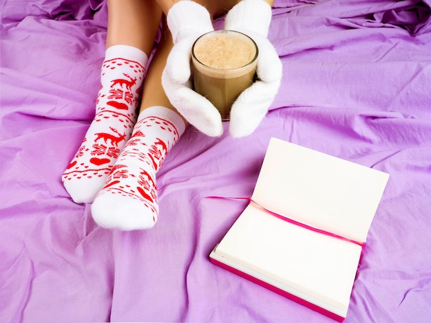Girl with a cup of coffee, next book, christmas setting, socks for christmas