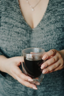 Girl with a cup of hot coffee in her hands