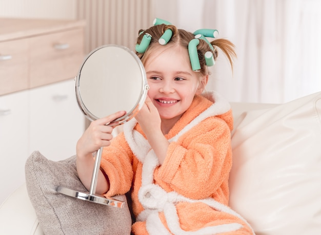 Girl with curlers smiling