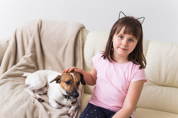 Girl with cute dog jack russell terrier on the couch