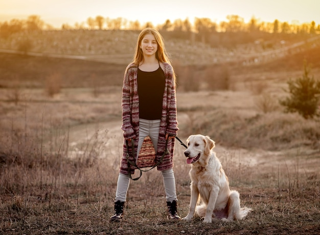 Girl with dog in nature
