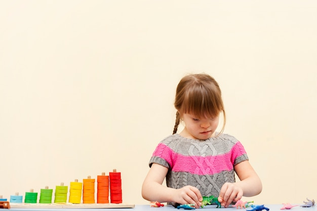 Girl with down syndrome playing with toys