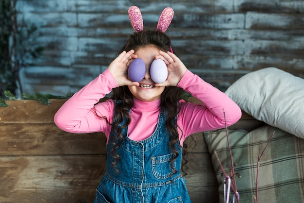 Girl with easter eggs smiling