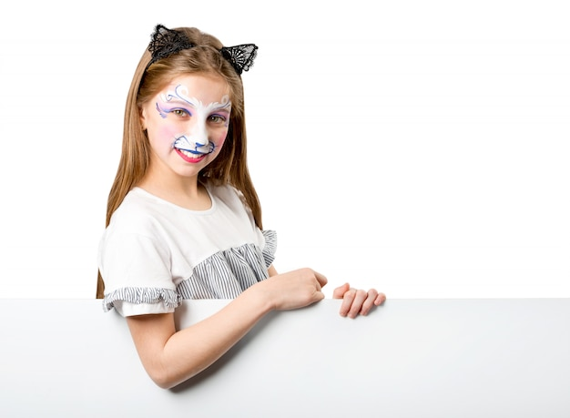 Girl with face painting holding white banner