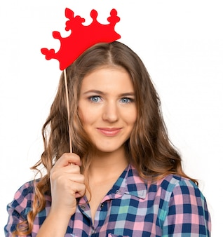 Girl with festive paper crown on her head.