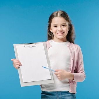 Girl with file holder and pan in studio