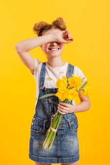 Girl with flowers covering eyes