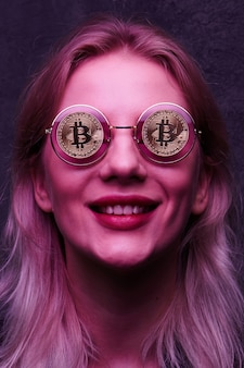 Girl with glasses with bitcoins