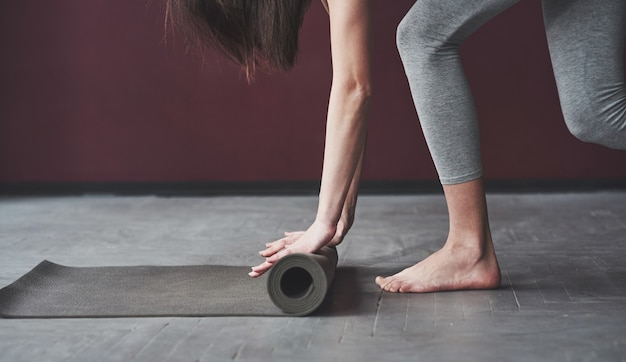 Girl with good fitness body type have exercises in the spacey room