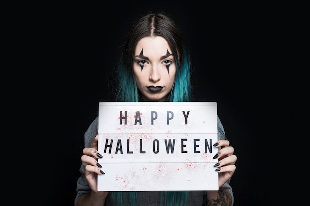 Girl with halloween makeup and signboard