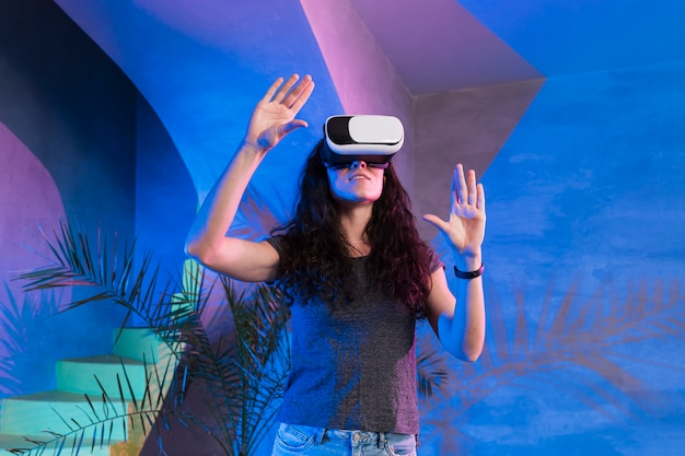 Girl with hands up wearing the vr set
