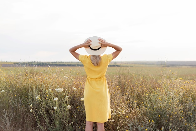 Girl with hat enjoying the nature after quarantine