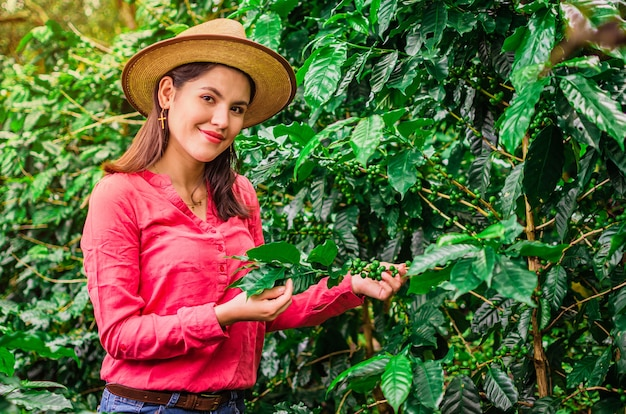 Girl with hat and pink shirt in coffee plantation