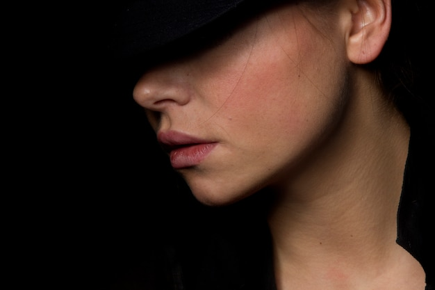 Girl with a hat posing