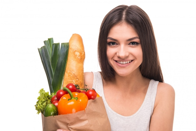 Girl with healthy food package smiling.