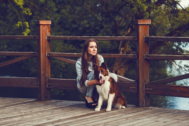 Girl with her dog border collie.