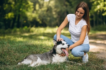 Girl with her dog in park