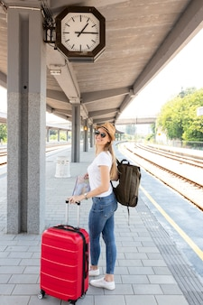 Girl with her luggage in a station