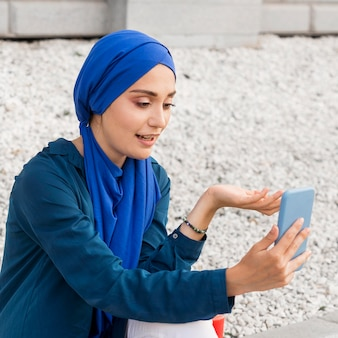 Girl with hijab video calling Free Photo