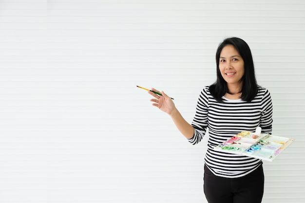 Girl with hobbies, drawing watercolors. make her happy and bright smile.